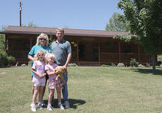 """<div class=""""source"""">Stephen Lega</div><div class=""""image-desc"""">In Calvary, the flood waters reached over the top step of the Bradys' log cabin. No one was injured and thanks to the efforts of friends and neighbors, most of the items in their house were removed before the waters could damage them.</div><div class=""""buy-pic""""><a href=""""/photo_select/1815"""">Buy this photo</a></div>"""