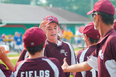 "<div class=""source"">Richard RoBards</div><div class=""image-desc"">Robbie Spalding is congratulated after his seventh inning double defeated Washington County 2-1 on Saturday.</div><div class=""buy-pic""><a href=""/photo_select/2632"">Buy this photo</a></div>"