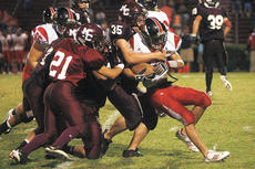 """<div class=""""source"""">Jesse Osbourne</div><div class=""""image-desc"""">Marion County High School sophomore Jeremy Mattingly led the pack while bringing down a Taylor County High School player in Marion County's 49-0 drubbing of Taylor County on Friday at John J. Boswell Field.</div><div class=""""buy-pic""""><a href=""""/photo_select/6944"""">Buy this photo</a></div>"""