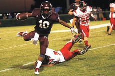 """<div class=""""source"""">Jesse Osbourne</div><div class=""""image-desc"""">Marion County High School senior Jordan Bell leap frogged a tackle against Taylor County High School during Danville's 6-1 win at Elmer J. George Field on Thursday.</div><div class=""""buy-pic""""><a href=""""/photo_select/6945"""">Buy this photo</a></div>"""