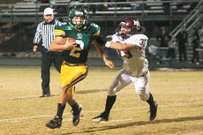 """<div class=""""source"""">Jesse Osbourne</div><div class=""""image-desc"""">Marion County's Clayton Smith gave chase to Green County's Cody Houchens in the Knights 42-21 loss to the Dragons on Friday in Greensburg. More photos from this events and others can be seen at www.jesseophoto.zenfolio.com.</div><div class=""""buy-pic""""><a href=""""/photo_select/7092"""">Buy this photo</a></div>"""