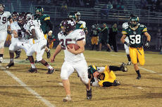 """<div class=""""source"""">Jesse Osbourne</div><div class=""""image-desc"""">Marion County's Jeremy Mattingly barreled down the field in one shoe in the Knights 42-21 loss to the Dragons on Friday in Greensburg.</div><div class=""""buy-pic""""><a href=""""/photo_select/7091"""">Buy this photo</a></div>"""