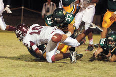 """<div class=""""source"""">Jesse Osbourne</div><div class=""""image-desc"""">Marion County's Jordan Bell fumbled inside the Knights 25-yard line to give Green County good field position in the second quarter of the Knights 42-21 loss to the Dragons on Friday in Greensburg. </div><div class=""""buy-pic""""><a href=""""/photo_select/7090"""">Buy this photo</a></div>"""