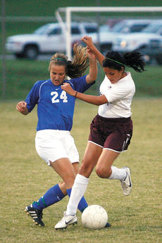 """<div class=""""source"""">Jesse Osbourne</div><div class=""""image-desc"""">Danville High School junior Megan Coleman battled Marion County High School senior Diana Almendra for a ball during Marion County's 1-0 loss against Danville at Elmer J. George Field on Tuesday of last week.</div><div class=""""buy-pic""""><a href=""""/photo_select/4020"""">Buy this photo</a></div>"""