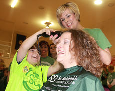 "<div class=""source"">Stephen Lega</div><div class=""image-desc"">Enterprise Publisher Stevie Lowery is the first shavee at this year's St. Baldrick's event. Her son, Owen, takes the first few swipes at her head with some help from stylist Nicole Thompson.</div><div class=""buy-pic""><a href=""http://web2.lcni5.com/cgi-bin/c2newbuyphoto.cgi?pub=015&orig=web-stevie_1.jpg"" target=""_new"">Buy this photo</a></div>"