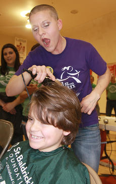 "<div class=""source"">Stephen Lega.</div><div class=""image-desc"">During Owen Daugherty's haircut, his mom, Stevie Lowery, takes the first swipe.</div><div class=""buy-pic""><a href=""/photo_select/33073"">Buy this photo</a></div>"