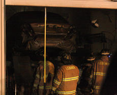 "<div class=""source"">Stephen Lega</div><div class=""image-desc"">Firefighters open the garage doors, exposing a couple vehicles inside the garage.</div><div class=""buy-pic""></div>"
