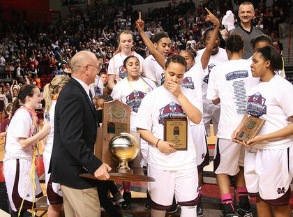 Makayla Epps was overcome with emotion when the Lady Knights were presented with the 2013 Girls Sweet Sixteen championship trophy.