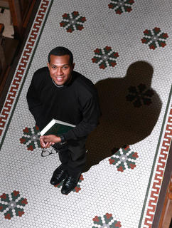 Fr. Christopher Rhodes, former associate pastor at St. Augustine and Holy Name of Mary Catholic churches, was the subject of a heartfelt portrait during a special series during Black History Month.