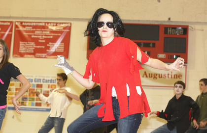 "St. Augustine Grade School celebrated National Catholic Schools Week with its annual talent show. Pictured is Carly Mattingly, eighth grade, performing a dance routine to ""Thriller"" with her classmates."
