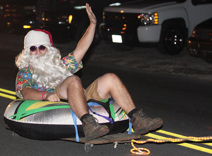 The City of Loretto was lively during its first-ever Christmas parade. Pictured is Eric Miles, dressed as Santa, went tubing down the road. His family's float, Christmas in July, included a boat, and several reindeer, including Prancer, Rudolph, Dancer and Blixen, who were all enjoying a vacation of sun tanning and fishing.