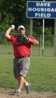 Larry Burchell throws the ball to the infield during the old-timers baseball game at Dave Hourigan Field Friday evening in Bradfordsville The game was part of the annual Old Mills Days festival.