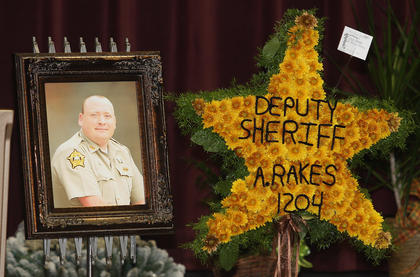 A photo of Marion County Sheriff's Deputy Anthony Rakes was placed near his coffin during his funeral, which was held at Marion County High School.  Rakes was killed Nov. 14.