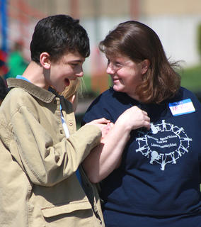 Evan Martin shares a laugh with Kim Ford in between races at the Special Kids/Special Talents Field Day held April 12 at Lebanon Elementary Schools.