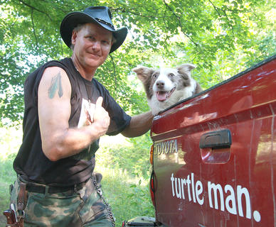 "Ernie Brown Jr. (front), better known as the Turtleman, had a breakout year in 2012 with the success of his show, ""Call of the Wildman,"" on Animal Planet. He is pictured with loyal companion, Lollie."
