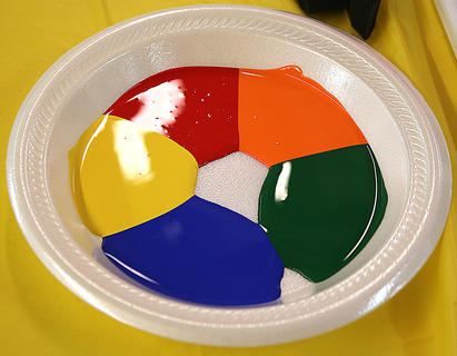 Vibrant paint colors were available for children to use for their paintings.