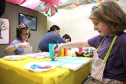 Anna Spalding and Isabella Turner begin to paint their works of art.