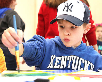 Zachary Knight concentrates as he creates his work of art.