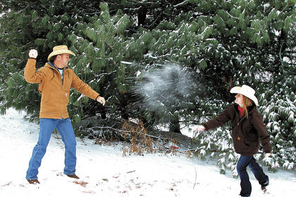Mignon and Ryan Carter have a snow fight.
