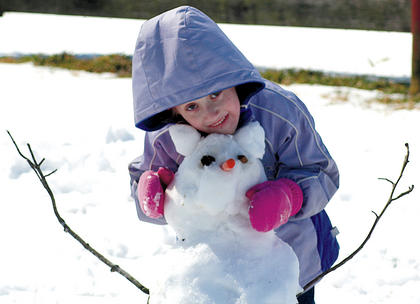 Sarah Hardin is pictured with her snow critter.