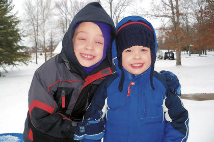 Will Knight, 6, and his brother, Zachary, 4, pose for a photo in the snow.