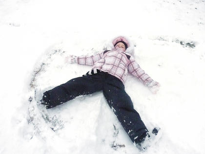Morgan Hunt makes a snow angel.