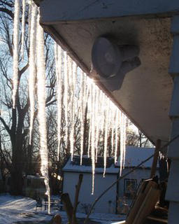 Icicles shimmer in the sunlight.