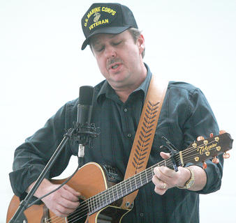 """Phillip Clarkson sings """"United States Marine"""" in the singer/songwriter competition Saturday afternoon."""