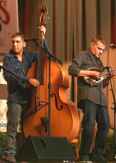 Blake Johnson, left, and Wayne Benson play with Russell Moore and IIIrd Tyme Out on Saturday evening. Johnson has been to the festival several times previously with the Hagar's Mountain Boys.