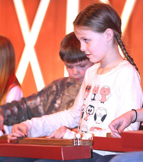 Halee May, right, and Ethan Murphy of Calvary Elementary play dulcimers with several of their classmates Friday evening. The Kentucky Fellowship of Musicians donated the dulcimers to the school.