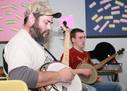 Mark King of Bloomfield, left, and Cody Kirkland of Huntsville, Alabama, take part in a banjo workshop Saturday afternoon.