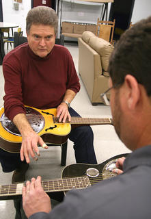 Johnny Bellar of the Ricky Reece Band instructs Brad Lanham during a dobro workshop Saturday afternoon at Marion County High School.