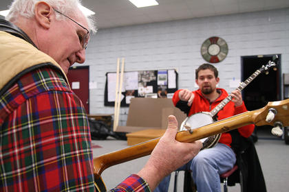 Jack Flippin practices the banjo during a workshop by Weston Stewart of the Ricky Reece Band on Saturday afternoon.