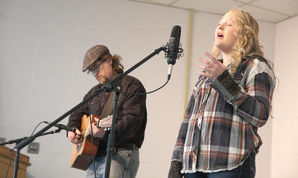 "Chloe Goss, 13, of Parksville sings ""Love So True"" while accompanied by her father, Michael Goss, during the singer-songwriter competition Saturday afternoon."