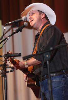 "Phillip Clarkson of Lebanon sings his original song ""Bradfordsville"" during Saturday evening's dinner show. Clarkson won this year's singer-songwriter competition at the Kentucky Bluegrass Music Kickoff."