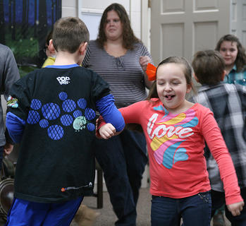 "Laurel Cochran dances with Dale Keeling during the ""Bluegrass in the Schools"" program, which was moved to the Marion County Public Library on Friday after school was called off."