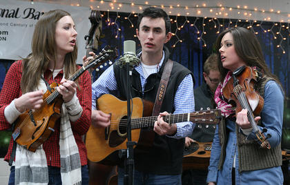 "Siblings Kelsi Harrigill, Buddy Robertson and Charli Robertson of Flatt Lonesome sing during the ""Bluegrass in the Schools"" program, which was moved to the Marion County Public Library on Friday after school was called off."