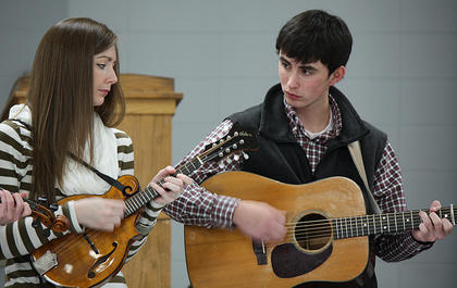 Kelsi Harrigill and Buddy Robertson strum with the rest of the band.