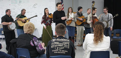 Prior to the workshops, attendees were treated to a performance by their mentors. Brad Lanham, center, introduced the musicians.