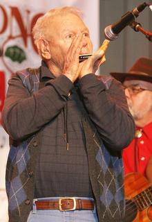 John Allison of Illinois plays his harmonica during Friday night's jam session.