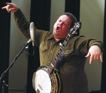 "Gary ""Biscuit"" Davis raps with his banjo."