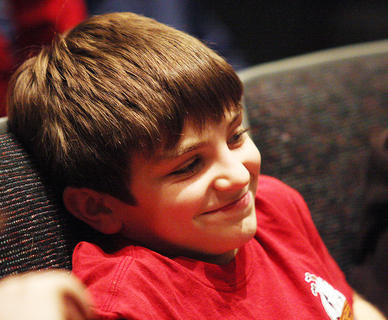 Jacob Goodin, a West Marion Elementary School student, laughs at some of Biscuit&#039;s funny antics on stage.