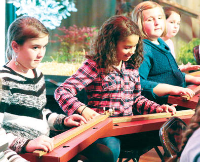 Maddie McDonald, Mea Mitchell, Lexi Osbourne and Samantha Douglas play dulcimers Friday evening at the Kentucky Bluegrass Music Kickoff.