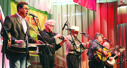 Marion County's own Honeysuckle String Band performs Friday evening during the Kentucky Bluegrass Music Kickoff. Pictured are, from left, Brad Lanham, Ray Mattingly, Joe Dant, Billy Hill, Eddie Mattingly and Danny Cecil.