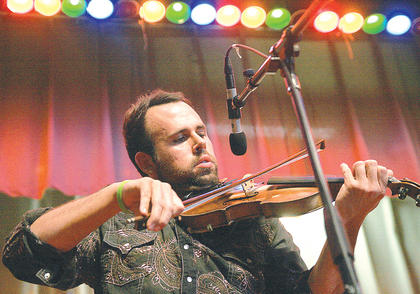 Jeremy Abshire fiddles around during The Grascals performance Saturday night at the Kentucky Bluegrass Music Kickoff. 