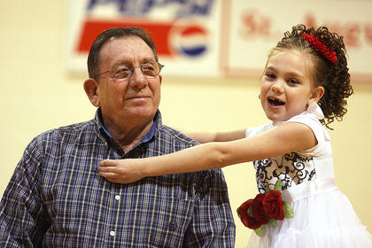 "Julia Rose Wheatley, first grade, sings Shirley Temple's ""Just the Right Somebody to Love"" to her grandfather, Bill Coy."