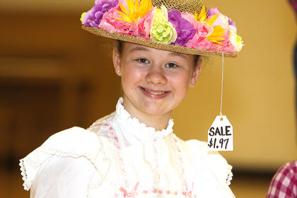 Jane Palagi, seventh grade, plays the part of Minnie Pearl during a Hee-Haw skit.