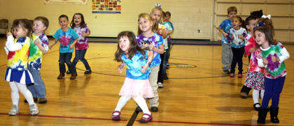 Pre-schoolers entertain the crowd with a special song and dance.