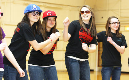 (From left) Eighth graders Mary Beth Childers, Leah Mudd, Paige Buckman and Rebecca Bowman get a little goofy while performing.