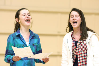 Twin sisters Katelyn and Samantha Daugherty, seventh-graders at St. A, perform a duet together during the talent show.
